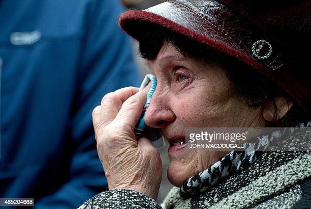 Valentina Dzuba mother of a miner cries outside the Zasyadko mine in Donetsk after the mine was rocked by an explosion on March 4 2015 At least 32...