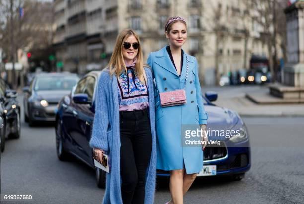 Valentina Ferragni and Chiara Ferragni wearing a blue coat platform shoes Chanel mini bag outside Miu Miu on March 7 2017 in Paris France