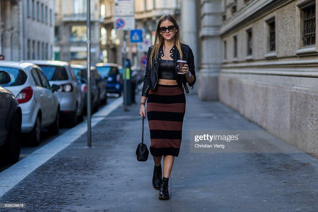 Valentina Ferragni wearing a Chanel bag No21 skirt Dr Martens boots Alexander Wang jacket outside Salvatore Ferragamo during Milan Men's Fashion Week...