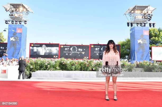 Valentina Lodovini walks the red carpet ahead of the 'The House By The Sea ' screening during the 74th Venice Film Festival at Sala Grande on...