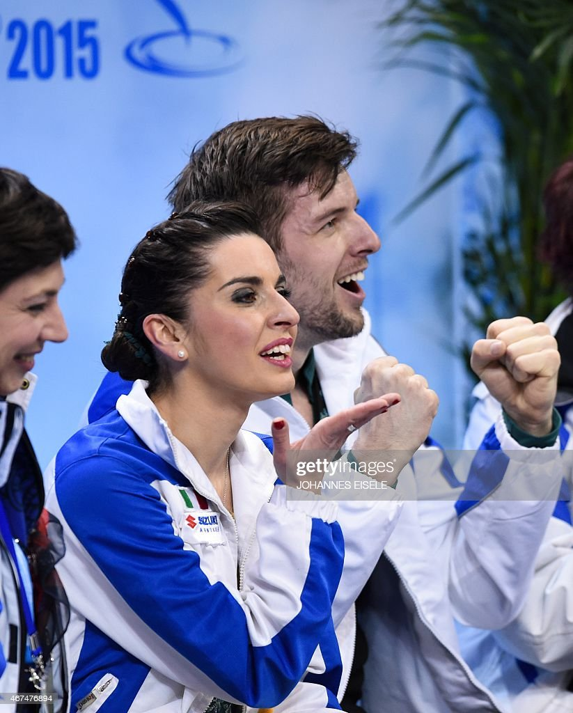 <a gi-track='captionPersonalityLinkClicked' href=/galleries/search?phrase=Valentina+Marchei&family=editorial&specificpeople=734432 ng-click='$event.stopPropagation()'>Valentina Marchei</a> (C) and Ondrej Hotarek (R) of Italy react after performing in the pairs short program of the 2015 ISU World Figure Skating Championships at Shanghai Oriental Sports Center in Shanghai, on March 25, 2015. AFP PHOTO / JOHANNES EISELE