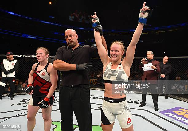Valentina Shevchenko celebrates her victory over Sarah Kaufman in their women's bantamweight bout during the UFC Fight Night event at the Amway...