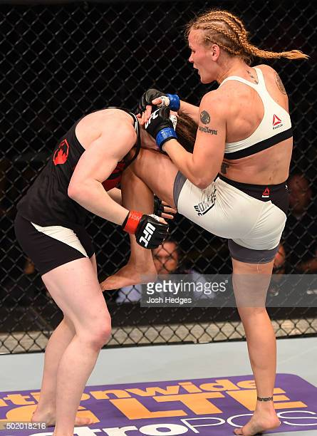 Valentina Shevchenko knees Sarah Kaufman in their women's bantamweight bout during the UFC Fight Night event at the Amway Center on December 19 2015...