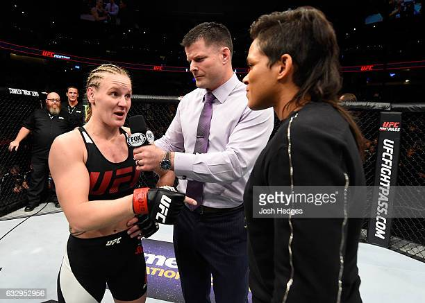Valentina Shevchenko of Kyrgyzstan and UFC women's bantamweight champion Amanda Nunes speak to Brian Stan during the UFC Fight Night event at the...