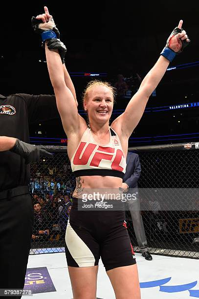Valentina Shevchenko of Kyrgyzstan celebrates after defeating Holly Holm by unanimous decision in their women's bantamweight bout during the UFC...