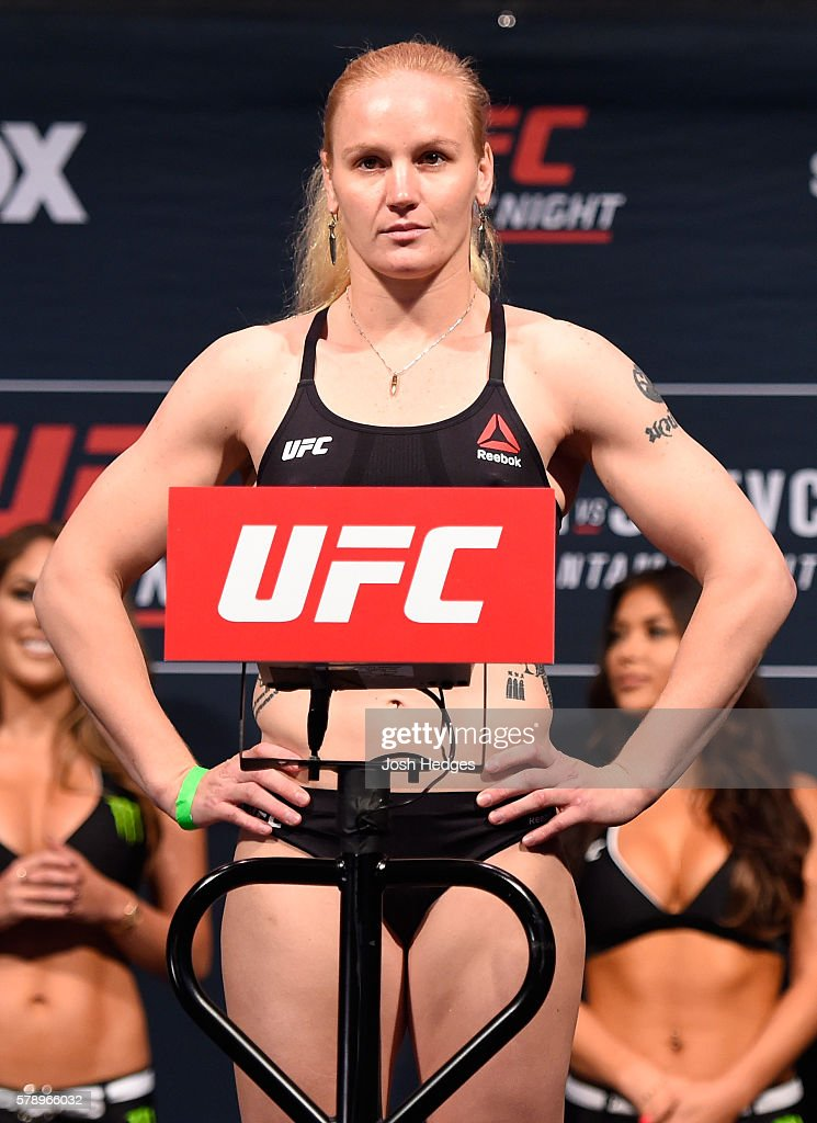 Valentina Shevchenko of Kyrgyzstan poses on the scale during the UFC weigh-in at the United Center on July 22, 2016 in Chicago, Illinois.