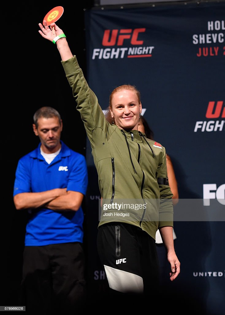 Valentina Shevchenko of Kyrgyzstan prepares to step onto the scale during the UFC weigh-in at the United Center on July 22, 2016 in Chicago, Illinois.