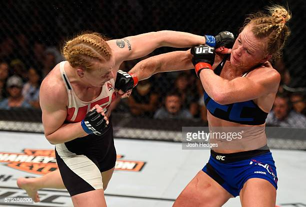 Valentina Shevchenko of Kyrgyzstan punches Holly Holm in their women's bantamweight bout during the UFC Fight Night event at the United Center on...