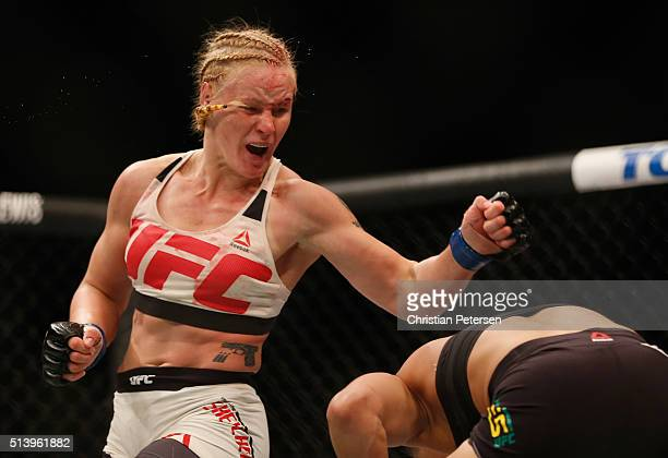 Valentina Shevchenko of Peru punches Amanda Nunes of Brazil in their women's bantamweight bout during the UFC 196 event inside MGM Grand Garden Arena...