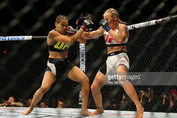 Valentina Shevchenko punches Amanda Nunes during UFC 196 at the MGM Grand Garden Arena on March 5 2016 in Las Vegas Nevada
