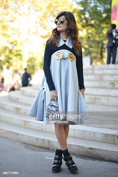 Valentina Siragusa poses wearing a Rochas dress Stella McCartney bag and Casadei shoes before the Rochas show at the Palais de Tokyo during Paris...