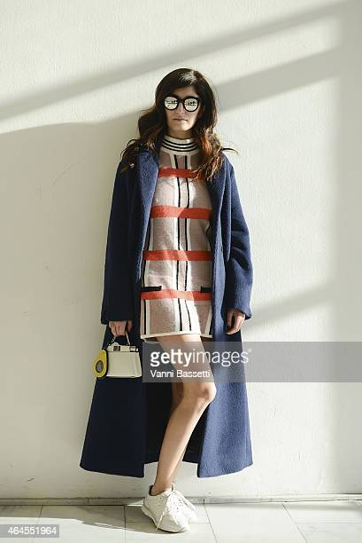 Valentina Siragusa poses wearing Giorgio Grati coat Silvian Heach dress and Geox shoes on February 26 2015 in Milan Italy