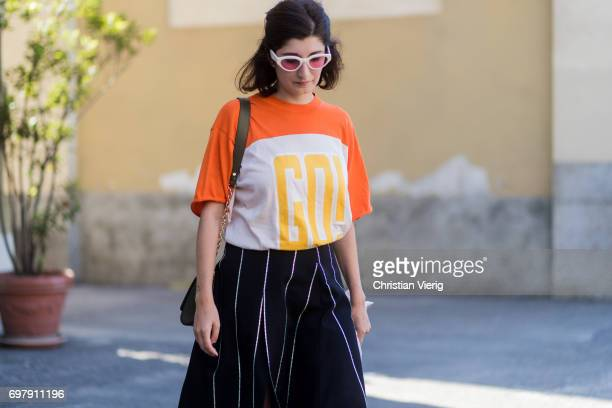 Valentina Siragusa wearing black white striped skirt orange tshirt is seen outside Malibu 1992 during Milan Men's Fashion Week Spring/Summer 2018 on...