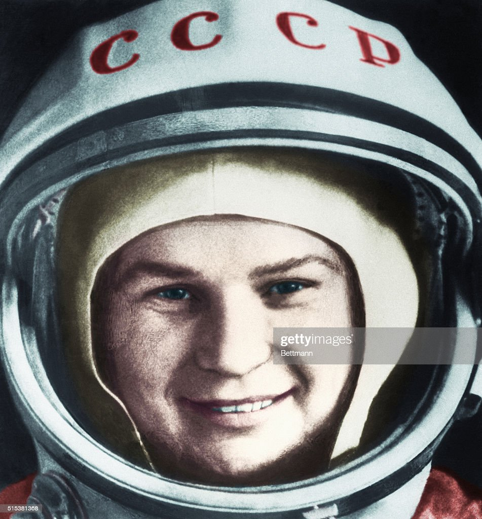 Valentina Tereshkova, the first woman sent into space, is shown wearing a space helmet.