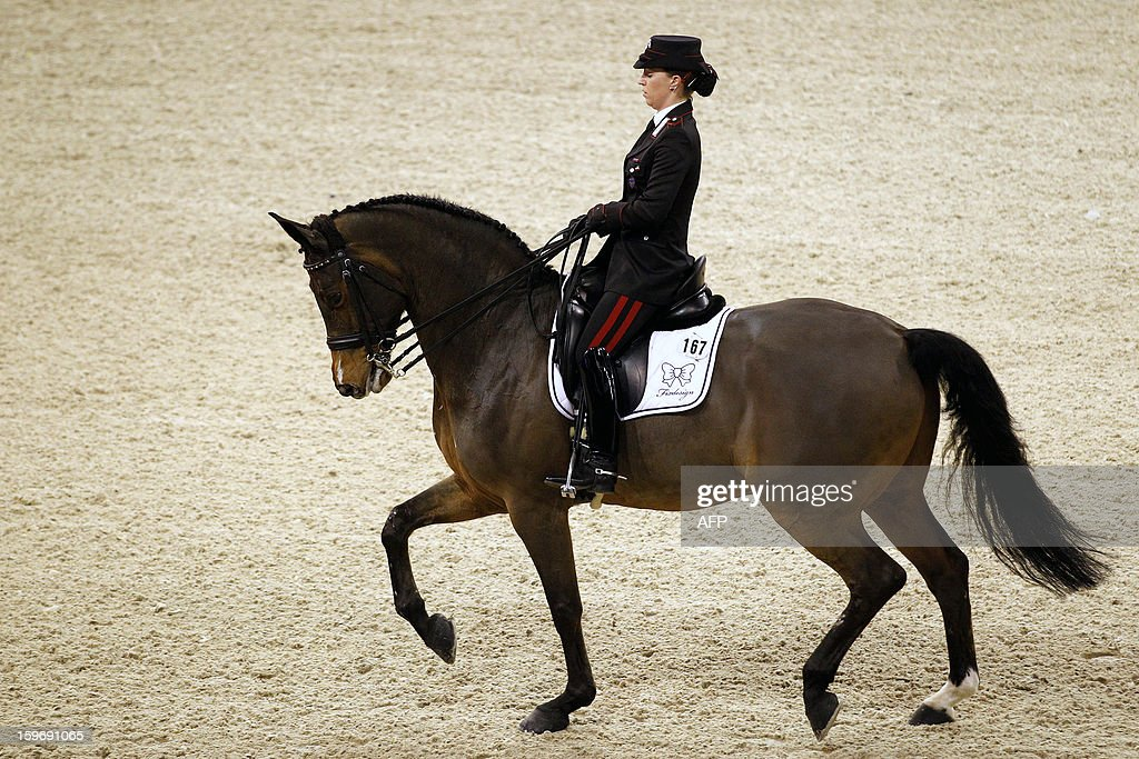 Valentina Truppa from Italy with Fixdesign Eremo del Castegno compete during the World Cup dressage at the Jumping Amsterdam, on January 18, 2013 in Amsterdam. AFP PHOTO/ANP/ BAS CZERWINSKI netherlands out