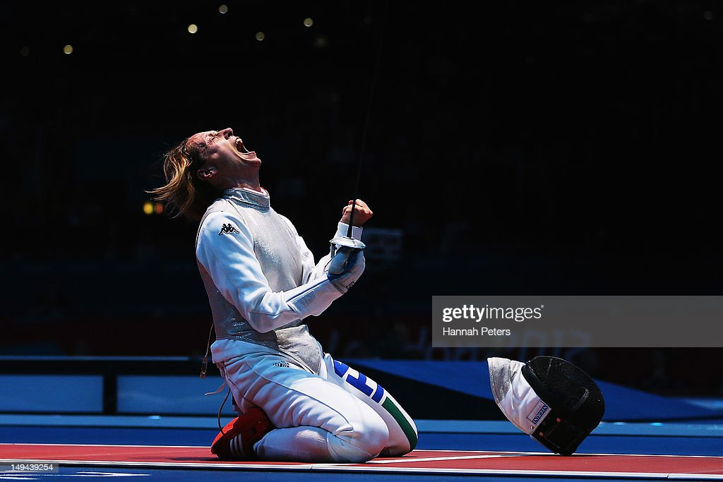 <a gi-track='captionPersonalityLinkClicked' href=/galleries/search?phrase=Valentina+Vezzali&family=editorial&specificpeople=772094 ng-click='$event.stopPropagation()'>Valentina Vezzali</a> celebrates winning her Women's Foil Individual Fencing Quaterfinal match against Ines Boubakri of Tunisia on Day 1 of the London 2012 Olympic Games at ExCeL on July 28, 2012 in London, England.