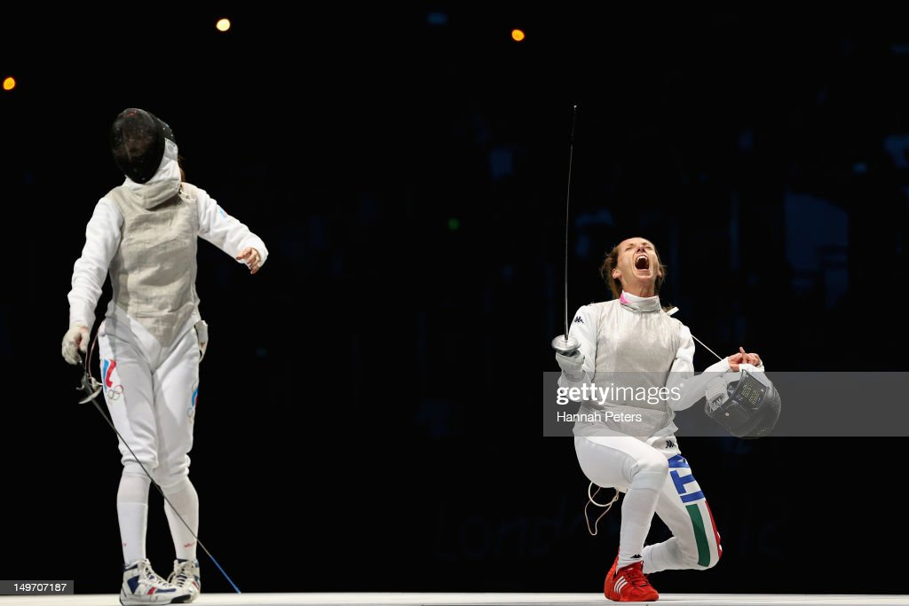 <a gi-track='captionPersonalityLinkClicked' href=/galleries/search?phrase=Valentina+Vezzali&family=editorial&specificpeople=772094 ng-click='$event.stopPropagation()'>Valentina Vezzali</a> of Italy celebrates as she wins gold during her contest with Larisa Korobeynikova of Russia in the Women's Foil Team Fencing gold medal match against Russia on Day 6 of the London 2012 Olympic Games at ExCeL on August 2, 2012 in London, England.
