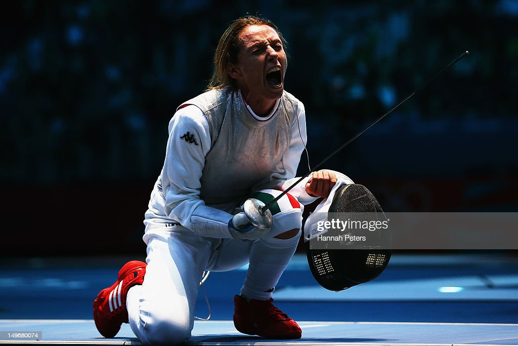 <a gi-track='captionPersonalityLinkClicked' href=/galleries/search?phrase=Valentina+Vezzali&family=editorial&specificpeople=772094 ng-click='$event.stopPropagation()'>Valentina Vezzali</a> of Italy celebrates beating Astrid Guyart of France in the Women's Foil Team Fencing semifinal on Day 6 of the London 2012 Olympic Games at ExCeL on August 2, 2012 in London, England.