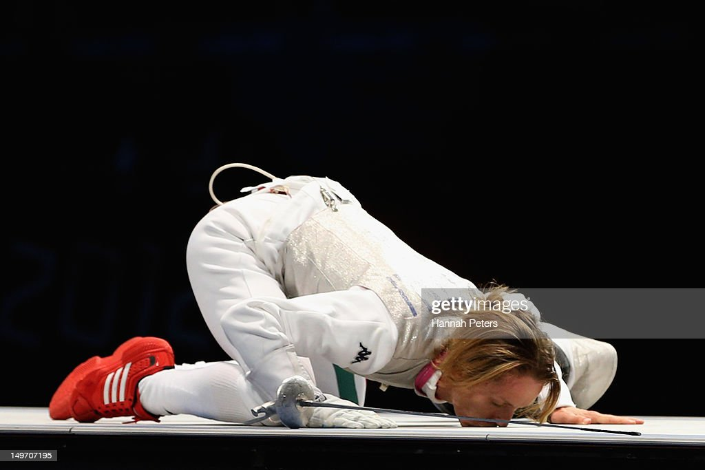 <a gi-track='captionPersonalityLinkClicked' href=/galleries/search?phrase=Valentina+Vezzali&family=editorial&specificpeople=772094 ng-click='$event.stopPropagation()'>Valentina Vezzali</a> of Italy kisses the mat as she celebrates winning gold during her contest with Larisa Korobeynikova of Russia in the Women's Foil Team Fencing gold medal match against Russia on Day 6 of the London 2012 Olympic Games at ExCeL on August 2, 2012 in London, England.