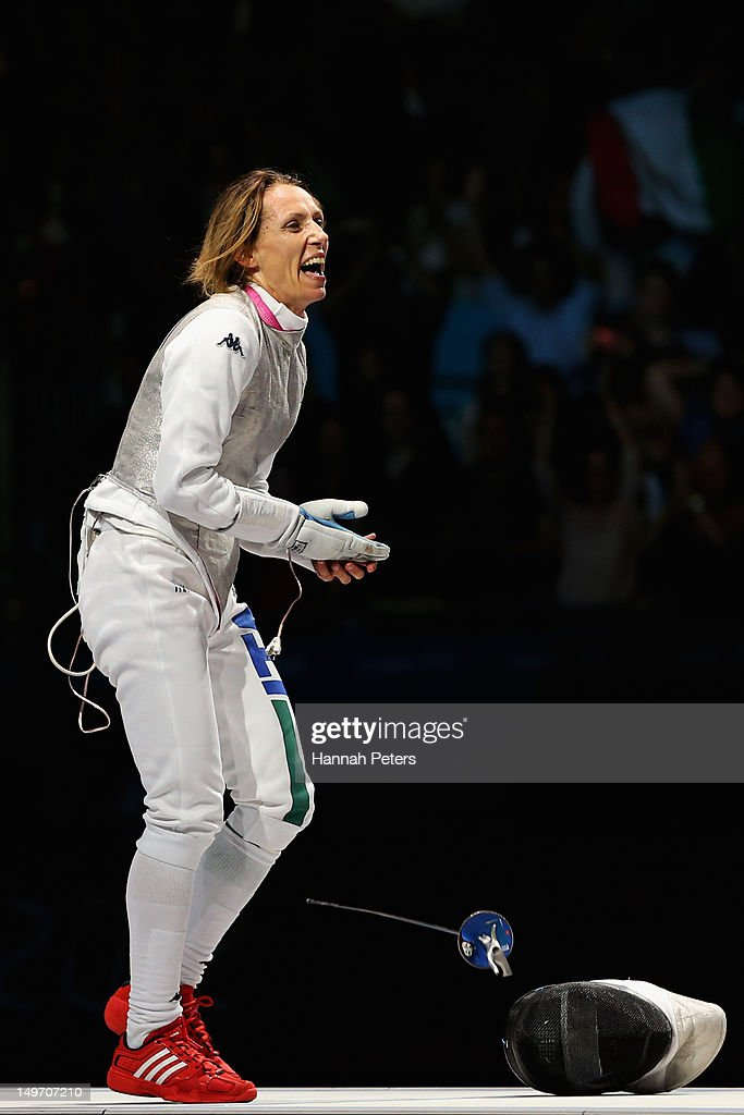 <a gi-track='captionPersonalityLinkClicked' href=/galleries/search?phrase=Valentina+Vezzali&family=editorial&specificpeople=772094 ng-click='$event.stopPropagation()'>Valentina Vezzali</a> of Italy reacts as she wins gold during her contest with Larisa Korobeynikova of Russia in the Women's Foil Team Fencing gold medal match against Russia on Day 6 of the London 2012 Olympic Games at ExCeL on August 2, 2012 in London, England.