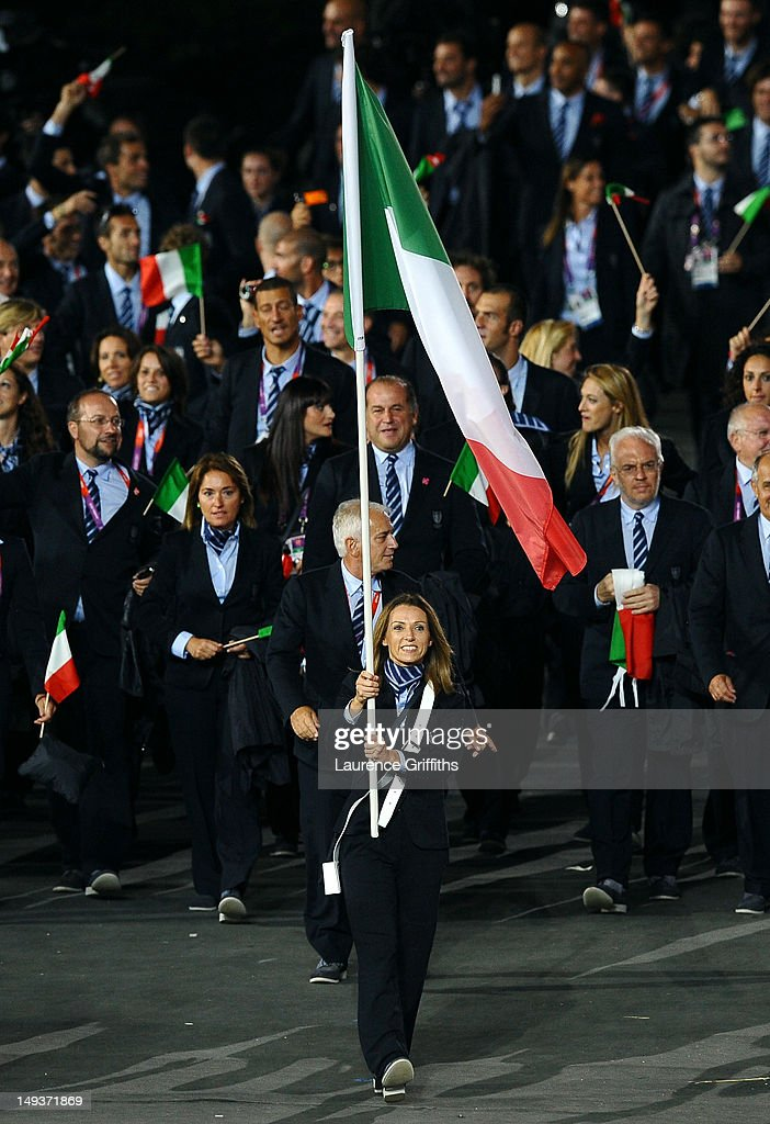 <a gi-track='captionPersonalityLinkClicked' href=/galleries/search?phrase=Valentina+Vezzali&family=editorial&specificpeople=772094 ng-click='$event.stopPropagation()'>Valentina Vezzali</a> of the Italy Olympic fencing team carries her country's flag during the Opening Ceremony of the London 2012 Olympic Games at the Olympic Stadium on July 27, 2012 in London, England.