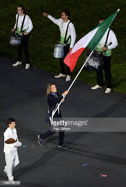 Valentina Vezzali of the Italy Olympic fencing team carries her country's flag during the Opening Ceremony of the London 2012 Olympic Games at the...