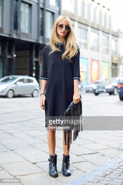 Valentina Viola poses wearing a Zara dress Stella McCartney sunglasses and Zanotti shoes on September 17 2014 in Milan Italy