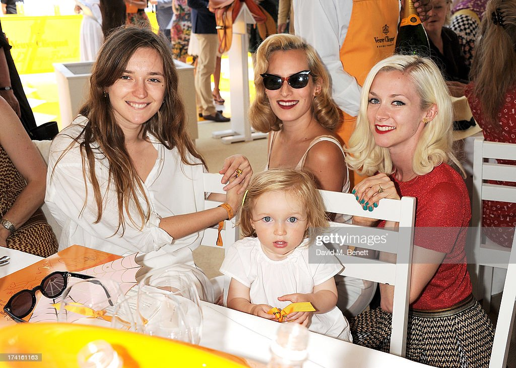 Valentine Fillol Cordier, Charlotte Dellal and Portia Freeman attend the Veuve Clicquot Gold Cup Final at Cowdray Park Polo Club on July 21, 2013 in Midhurst, England.