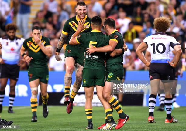 Valentine Holmes of Australia is congratulated by team mates after scoring a try during the 2017 Rugby League World Cup Semi Final match between the...