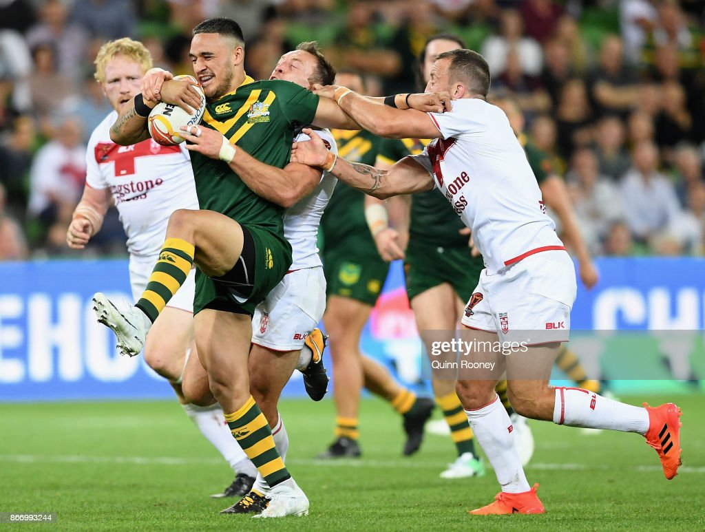 Valentine Holmes of Australia is tackled during the 2017 Rugby League World Cup match between the Australian Kangaroos and England at AAMI Park on October 27, 2017 in Melbourne, Australia.