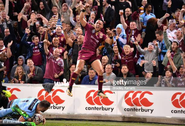 Valentine Holmes of the Maroons celebrates scoring a try during game three of the State Of Origin series between the Queensland Maroons and the New...