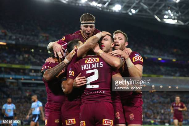 Valentine Holmes of the Maroons celebrates scoring a try with team mates during game two of the State Of Origin series between the New South Wales...