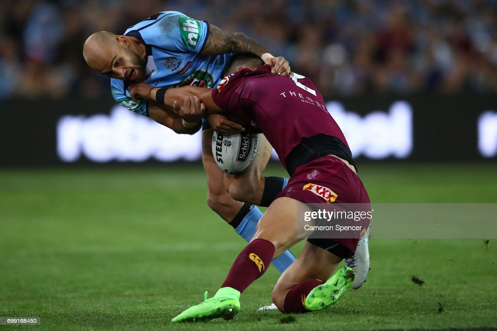 Valentine Holmes of the Maroons is tackled by Blake Ferguson of the Blues during game two of the State Of Origin series between the New South Wales Blues and the Queensland Maroons at ANZ Stadium on June 21, 2017 in Sydney, Australia.