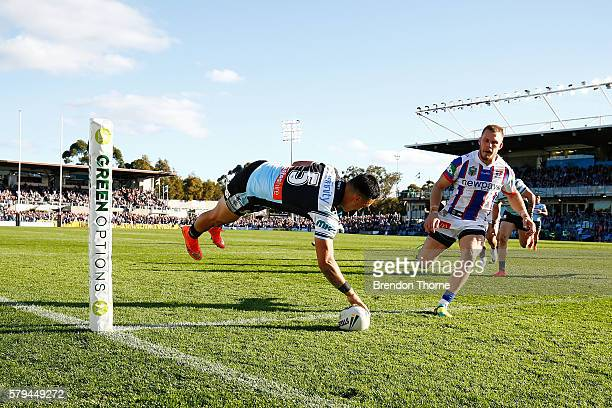 Valentine Holmes of the Sharks dives to score a try during the round 20 NRL match between the Cronulla Sharks and the Newcastle Knights at Southern...