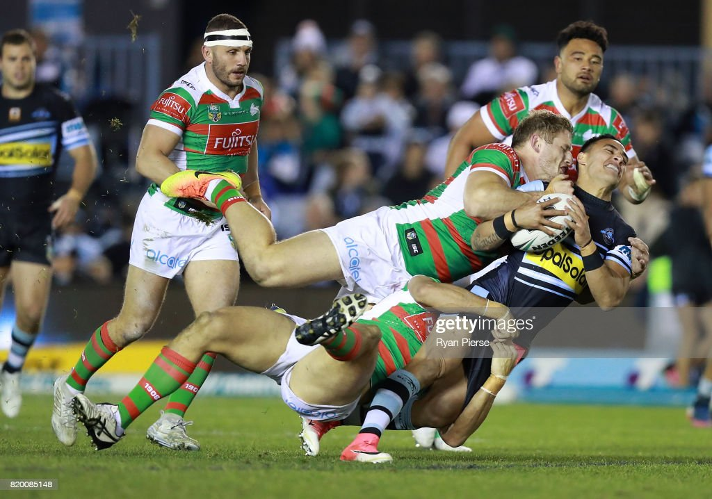 Valentine Holmes of the Sharks is tackled by George Burgess of the Rabbitohs during the round 20 NRL match between the Cronulla Sharks and the South Sydney Rabbitohs at Southern Cross Group Stadium on July 21, 2017 in Sydney, Australia.
