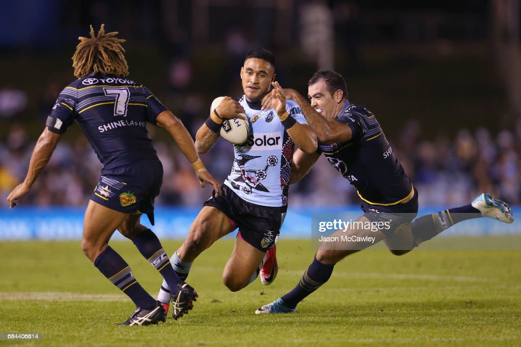 Valentine Holmes of the Sharks is tackled by Kane Linnett of the Cowboys during the round 11 NRL match between the Cronulla Sharks and the North Queensland Cowboys at Southern Cross Group Stadium on May 18, 2017 in Sydney, Australia.