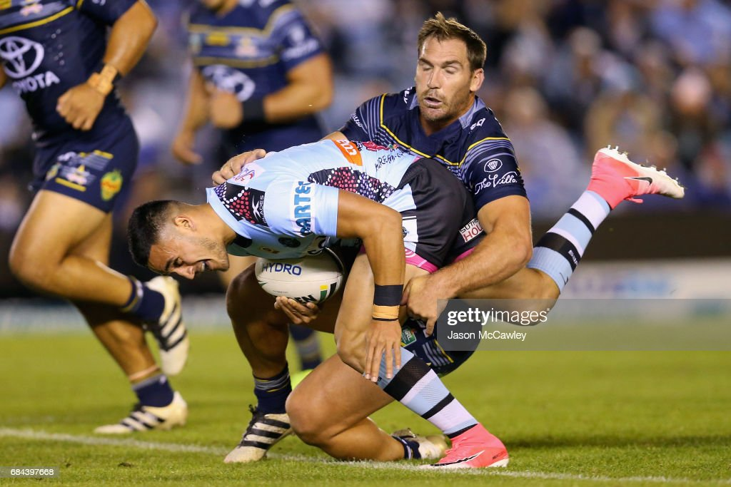 Valentine Holmes of the Sharks is tackled by Scott Bolton of the Cowboys during the round 11 NRL match between the Cronulla Sharks and the North Queensland Cowboys at Southern Cross Group Stadium on May 18, 2017 in Sydney, Australia.