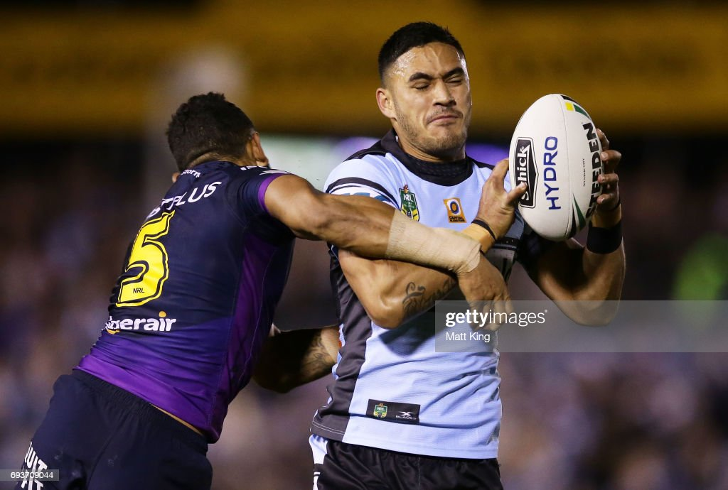Valentine Holmes of the Sharks is tackled during the round 14 NRL match between the Cronulla Sharks and the Melbourne Storm at Southern Cross Group Stadium on June 8, 2017 in Sydney, Australia.