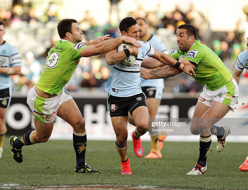 Valentine Holmes of the Sharks is tackled during the round 19 NRL match between the Canberra Raiders and the Cronulla Sharks at GIO Stadium on July 18, 2015 in Canberra, Australia.
