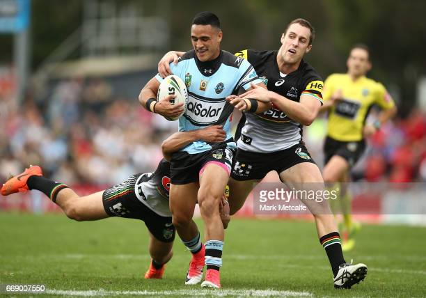 Valentine Holmes of the Sharks is tackled during the round seven NRL match between the Penrith Panthers and the Cronulla Sharks at Pepper Stadium on...