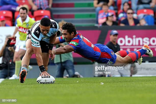 Valentine Holmes of the Sharks scores a try during the round 10 NRL match between the Newcastle Knights and the Cronulla Sharks at Hunter Stadium on...