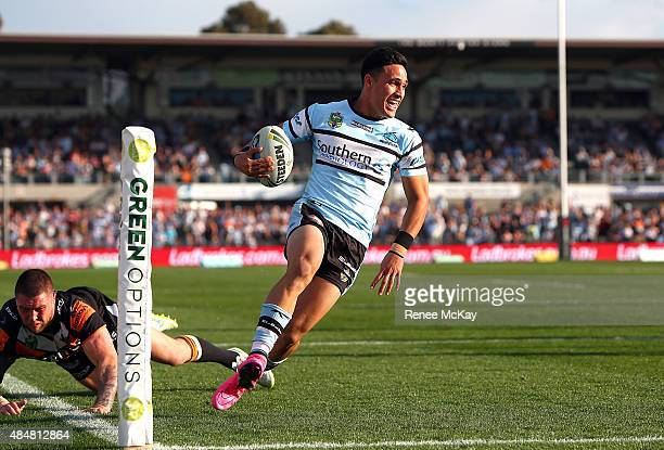 Valentine Holmes of the Sharks scores a try during the round 24 NRL match between the Cronulla Sharks and the Wests Tigers at Remondis Stadium on...