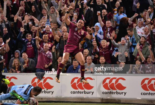 Valentine Homes of the Maroons celebrates after scoring a try during game three of the State Of Origin series between the Queensland Maroons and the...