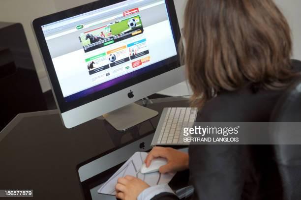 Valentine Proust gambles online on June 10 2010 in Paris using the 'Officiel des Paris en Ligne' gaming website placing bets for the June 11 World...