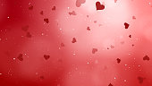 Valentines Day abstract background and love concept. Red heart shape, glittering light elements with bokeh decorations design for romantic background.