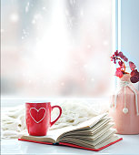Valentine's day background.Red mug with heart on window still empty copy space backdrop.
