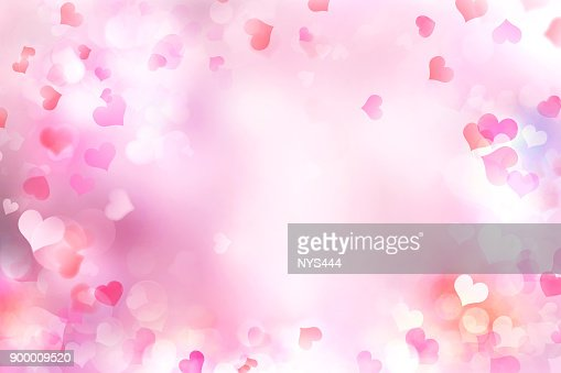 Valentine's day blurred hearts background. : Stock Photo
