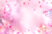 Valentine's day blurred hearts background.Pink romantic backdrop,