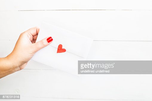 Valentines Day Concept A Woman Holds A Love Letter In Her Hand In An