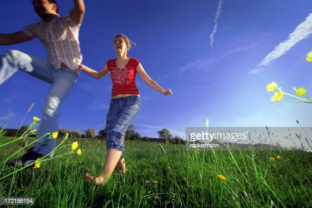 valentine's day couple in love jumping on meadow
